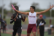 Seaver Cardoza of Long Beach Wilson (right) celebrates after defeating Namir Hemphill of Upland on the anchor of the 4 x 400m relay, 3:13.86 to 3:13.97, during the 2019 CIF Southern Section Masters Meet in Torrance, Calif., Saturday, May 18, 2019.
