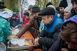 November 10, 2018 - Tambov, Tambov region, Russia - Treat with scrambled eggs guests of the rally-concert, in honor of national Unity Day, in Tambov (Credit Image: © Demian Stringer/ZUMA Wire)