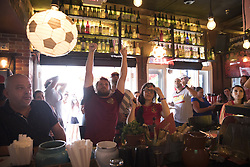 July 1, 2018 - Miami Beach, FL, USA - Kevin Zatkovich, 32, reacts to a Russia goal at Tapas and Tintos, a restaurant in Miami Beach, Fla. where fans gathered to watch Spain take on Russia during the 2018 FIFA World Cup Round of 16 knockout stage on Sunday, July 1, 2018. After the score being tied 1-1 at the end of extra time, Russia won, 4 penalty kicks to 3. (Credit Image: © Ellis Rua/TNS via ZUMA Wire)