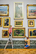 The return and rehanging of the nation&rsquo;s Pre-Raphaelite works, including Millais&rsquo; Ophelia (pictured centre bottom), to Tate Britain. They are going back on display from Thursday 7 August 2014 after being seen by over 1.1 million people worldwide. They include: John Everett Millais&rsquo; , Ophelia; Beata Beatrix by Dante Gabriel Rossetti; The Lady of Shalott by John William Waterhouse; The Beloved by Rossetti; and Mariana by John Everett Millais. These works are being displayed in the 'grand' surroundings of the 1840 galleries as part of the BP Walk through British Art. <br /> Millbank,  London, UK.