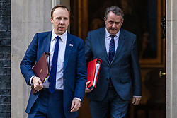 © Licensed to London News Pictures. 02/04/2019. London, UK. Secretary of State for Health and Social Care Matt Hancock (L) and Secretary of State for International Trade Liam Fox (R) leave 10 Downing Street after Prime Minister Theresa May delivered a statement announcing that she will seek a further extension of Article 50. Photo credit: Rob Pinney/LNP