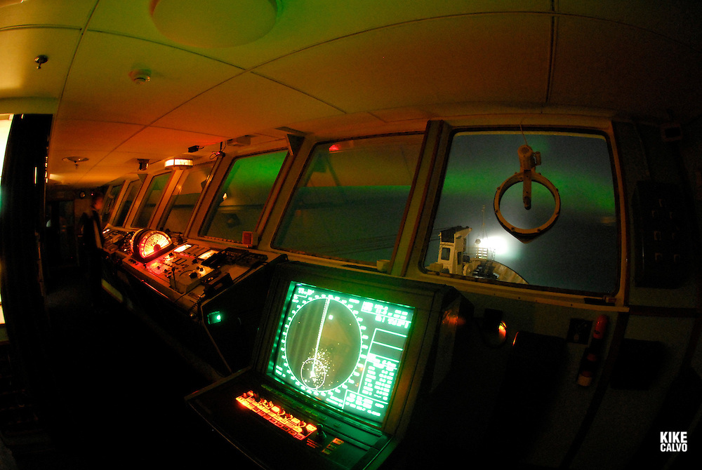 Vessel brigde lighted by the Northern lights or Aurora borealis on the Arctic night sky, viewed from Orlova Russian Icebreaker, High Arctic. Canada<br /> ( night, nocturnal, show, colorful, green, red, spectacule, weather, atmosphere, radar, equipment, safety, navigation, sonar, chat.