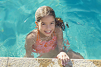 Girl in swimming pool, portrait