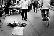Xinjiiang Uygur Autonomous region. Kashgar. A boy begs in the streets of Kashgar near the Ad Kah Mosque.