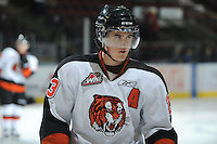 KELOWNA, CANADA, OCTOBER 11:  Alex Theriau #23 of the Medicine Hat Tigers warms-up as the Medicine Hat Tigers visited the Kelowna Rockets on October 11, 2011 at Prospera Place in Kelowna, British Columbia, Canada (Photo by Marissa Baecker/shootthebreeze.ca) *** Local Caption ***Alex Theriau;
