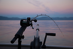 """Sunrise Fishing on Lake Tahoe 7"" - Photograph of a fishing pole and down rigger fishing on Lake Tahoe at sunrise."