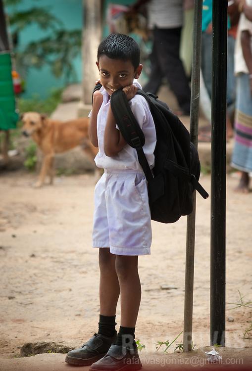 A school boy in his school uniform, smiles in Balangoda, Sri Lanka, on February 28, 2011. Photo Rafa Rivas