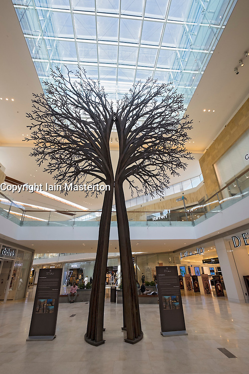 Tree sculpture inside new Yas Mall shopping centre on Yas Island in Abu Dhabi United Arab Emirates