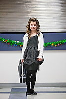 Rheana stands with her violin case following her Christmas recital held Dec. 14, 2011 at Skyway Elementary in Coeur d'Alene, Idaho. She practiced daily trying to master her songs for the concert.
