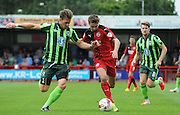 Dannie Bulman tries to disposess Gwion Edwards during the Sky Bet League 2 match between Crawley Town and AFC Wimbledon at the Checkatrade.com Stadium, Crawley, England on 15 August 2015. Photo by Michael Hulf.