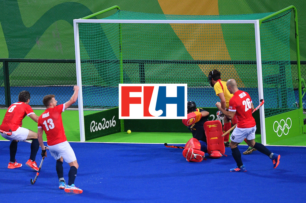 Great Britain's Sam Ward (2nd L) celebrates scoring a goal during the mens's field hockey Britain vs Spain match of the Rio 2016 Olympics Games at the Olympic Hockey Centre in Rio de Janeiro on August, 12 2016. / AFP / Carl DE SOUZA        (Photo credit should read CARL DE SOUZA/AFP/Getty Images)