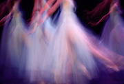 torsos of corps d' ballet in long tutus with motion blur