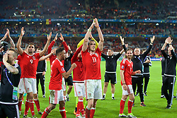 LILLE, FRANCE - Friday, July 1, 2016: Wales players applaud the supporters as they celebrate the 3-1 victory against Belgium at full time after the UEFA Euro 2016 Championship Quarter-Final match at the Stade Pierre Mauroy. Hal Robson-Kanu, Neil Taylor, Gareth Bale, Joe Allen. (Pic by Paul Greenwood/Propaganda)