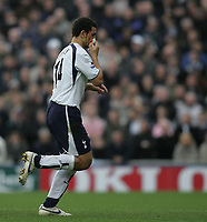 Photo: Lee Earle.<br /> Portsmouth v Tottenham Hotspur. The Barclays Premiership. 01/01/2007. Tottenham's Hossam Ghaly leaves the pitch after receiving an injury.
