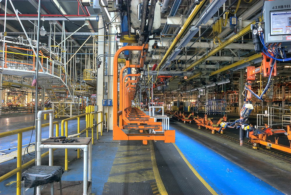 Seat carriers on chassis line, notice the U.S. flag and tools on the empty work bench, Chrysler Newark main assembly plant, HDR image