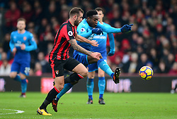 Danny Welbeck of Arsenal battles for the ball with Steve Cook of Bournemouth - Mandatory by-line: Alex James/JMP - 14/01/2018 - FOOTBALL - Vitality Stadium - Bournemouth, England - Bournemouth v Arsenal - Premier League