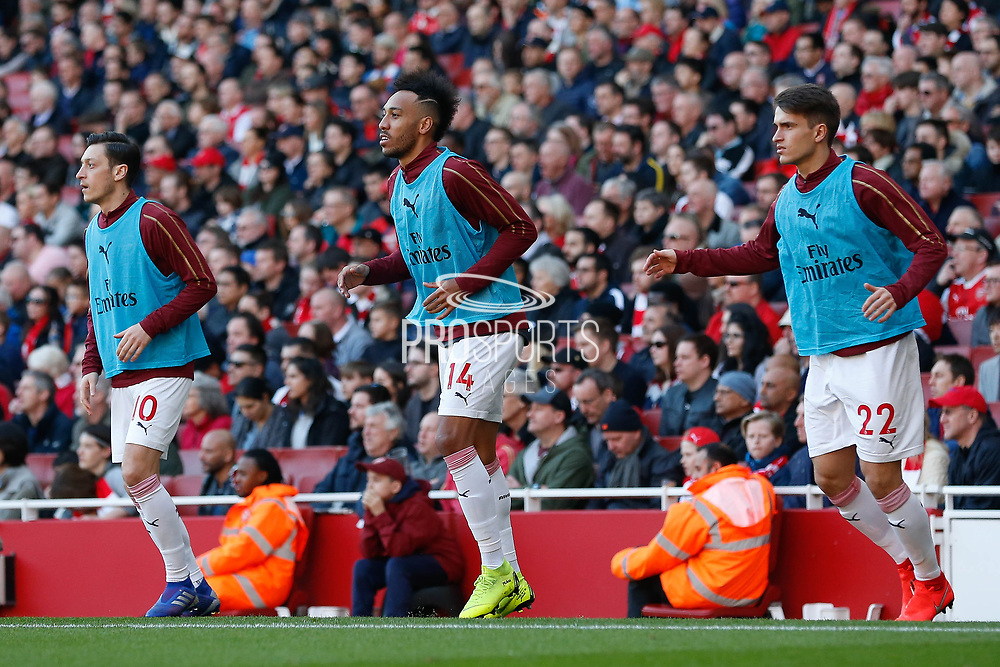 Arsenal midfielder Mesut Ozil (10) Arsenal forward Pierre-Emerick Aubameyang (14) and Arsenal midfielder Denis Suarez (22) warming up  during the Premier League match between Arsenal and Southampton at the Emirates Stadium, London, England on 24 February 2019.