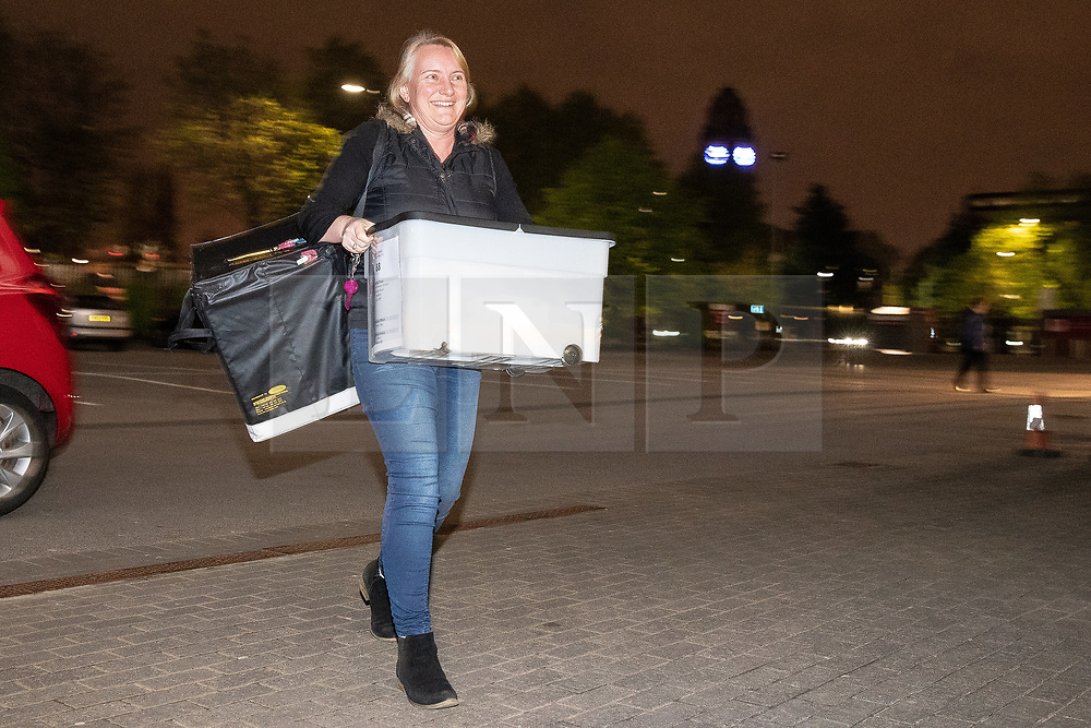 © Licensed to London News Pictures . 03/05/2018. Trafford, UK. Boxes from the first ward back ( Gorse Hill ) are carried in from the Polling Station at Gorse Hill Primary School . The Trafford Council count at The Point at Lancashire County Cricket Club . The Labour Party are looking to overturn the Conservative Party's majority on the council . Local council elections are taking place across the country . Photo credit : Joel Goodman/LNP