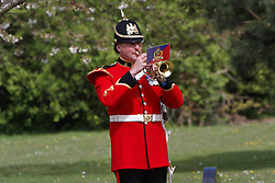 © Licensed to London News Pictures. 19/04/2012. DIDCOT, UK. A bugler plays the Last Post  at the funeral of Lance Corporal Michael Foley, Adjutant General's Corps (Staff and Personnel Support). Foley was shot dead by an Afghan soldier on March 26. He is survived by his wife Sophie (not pictured) and their three young sons who did not attend the service. Photo credit :  Cliff Hide/LNP