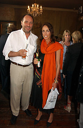 The HON.DAVID MACMILLAN and EMMA HANBURY at a party to celebrate the publication of Title Deeds by Liza Campbell at the First Floor, 186 Portobello Road, London on 14th June 2006.<br /><br />NON EXCLUSIVE - WORLD RIGHTS