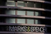 The logo and architecture of UK retailer Marks & Spencer, on Bishopsgate in the City of London.