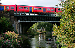 UK ENGLAND LONDON 9AUG06 - Local train passes over the urban river Wandle near Wimbledon in south London.. . jre/Photo by Jiri Rezac. . © Jiri Rezac 2006. . Contact: +44 (0) 7050 110 417. Mobile:  +44 (0) 7801 337 683. Office:  +44 (0) 20 8968 9635. . Email:   jiri@jirirezac.com. Web:    www.jirirezac.com. . © All images Jiri Rezac 2006 - All rights reserved.