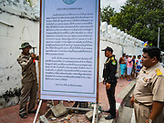 15 AUGUST 2016 - BANGKOK, THAILAND: Bangkok city officials put up eviction notices at the entrances of the Pom Mahakan slum in Bangkok. Final eviction notices were posted today and residents of the slum have been told they must leave the fort by September 3, 2016. The Pom Mahakan community is known for fireworks, fighting cocks and bird cages. Mahakan Fort was built in 1783 during the reign of Siamese King Rama I. It was one of 14 fortresses designed to protect Bangkok from foreign invaders. Only two of the forts are still standing, the others have been torn down. A community developed in the fort when people started building houses and moving into it during the reign of King Rama V (1868-1910). The land was expropriated by Bangkok city government in 1992, but the people living in the fort refused to move. In 2004 courts ruled against the residents and said the city could take the land.      PHOTO BY JACK KURTZ