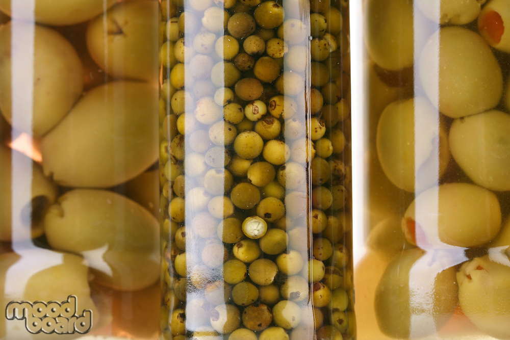 Close up of pickled olives in jar