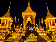 13 DECEMBER 2017 - BANGKOK, THAILAND:  People use their smart phone to photograph the Royal Crematorium on Sanam Luang in Bangkok. The crematorium was used for the funeral of Bhumibol Adulyadej, the Late King of Thailand. He was cremated on 26 October 2017. The crematorium is open to visitors until 31 December 2017. It will be torn down early in 2018. More than 3 million people have visited the crematorium since it opened to the public after the cremation of the King.    PHOTO BY JACK KURTZ
