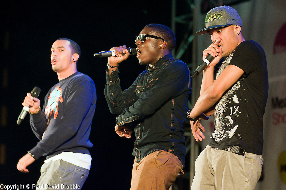 "Up and coming Boy band ""Encore"" featuring singers Mark and Cairo and rapper Pierre perform at Meadowhalls Christmas lights switch on concert in Sheffield on Thursday evening 3 November 2011. Image © Paul David Drabble"
