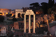 Temple of Castor and Pollux, inaugurated in 484 BC, restored in 117 BC by Lucius Metellus Dalmaticus and finally totally rebuilt by Tiberius in the early 1st century AD, Arch of Titus and Colosseum or Flavian Amphitheatre in the background, Roman Forum, Rome, Italy. Picture by Manuel Cohen