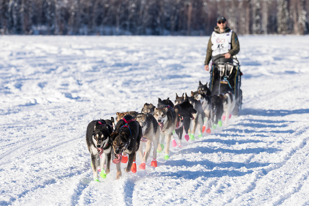 Musher Jeff Deeter after the restart in Willow of the 46th Iditarod Trail Sled Dog Race in Southcentral Alaska.  Afternoon. Winter.