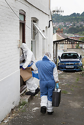 © Licensed to London News Pictures. 19/09/2016. High Wycombe, UK.  Forensics officers are seen entering a property in High Wycombe, Buckinghamshire, where detectives have launched a murder investigation following the death of a woman. A man has been arrested on suspicion of murder. Photo credit: Peter Macdiarmid/LNP