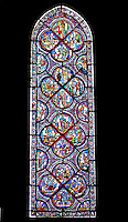 Our Lady of Chartres Cathedral, Chartres, France. Large, lancet  stained glass window, one of many which depict either lives of saints, local laborers, tradesmen and New or Old Testament stories.