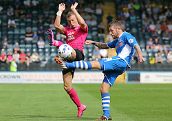 Marcus Maddison of Peterborough United blocks a clearance from Thomas Kennedy of Rochdale - Mandatory byline: Joe Dent/JMP - 07966386802 - 08/08/2015 - FOOTBALL - Spotland Stadium -Rochdale,England - Rochdale AFC v Peterborough United - Sky Bet League One