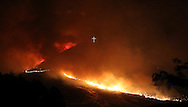 A wildfire fire burns near the Table Rock cross in Boise, ID in the early morning hours of June 30th, 2016.