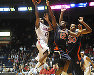 Ole Miss' Chris Warren (12) vs. Auburn's Dewayne Reed (12) and Brenden Knox (30) in Oxford, Miss. on Wednesday, February 24, 2010. Ole Miss won 85-75, giving Kennedy his 100th win as a head coach.