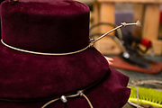 A felt hat on a mold with cords called ropes holding the shapes of the crown and brim.