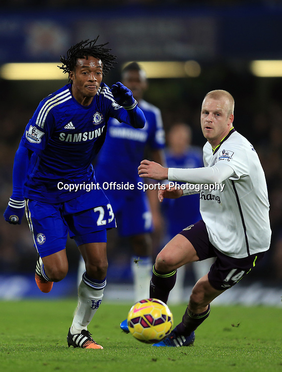 11 February 2015 - Barclays Premier League - Chelsea v Everton - Juan Cuadrado of Chelsea in action with Steven Naismith of Everton - Photo: Marc Atkins / Offside.