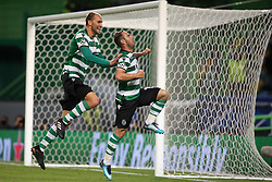 November 22, 2017 - Lisbon, Portugal - Sporting's midfielder Bruno Cesar from Brazil (R ) celebrates with Sporting's forward Bas Dost from Holland after scoring a goal during the UEFA Champions League group D football match Sporting CP vs Olympiacos FC at Alvalade stadium in Lisbon, Portugal on November 22, 2017. Photo: Pedro Fiuza  (Credit Image: © Pedro Fiuza/NurPhoto via ZUMA Press)