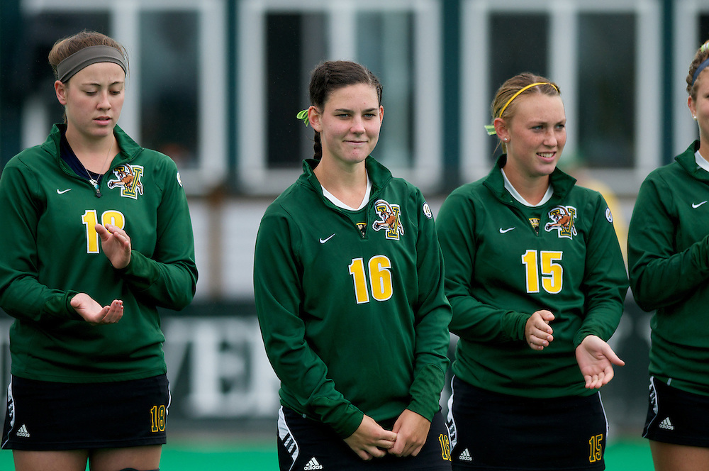 Catamounts midfielder Sally Snickenberger (16), Catamounts defenseman Katie Murray (18) and Catamounts midfielder Aria Robinson (15) during player introductions before the start of the women's field hockey game between the Maine Black Bears and the Vermont Catamounts at Moulton/Winder Field on Saturday afternoon September 29, 2012 in Burlington, Vermont.