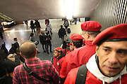 Manhattan, N.Y. November 15, 2013. The Guardian Angels take the escalator into Penn Station at the start of a patrol. 11/15/2013. Photo by Paul McCaffrey/NYCity Photo Wire