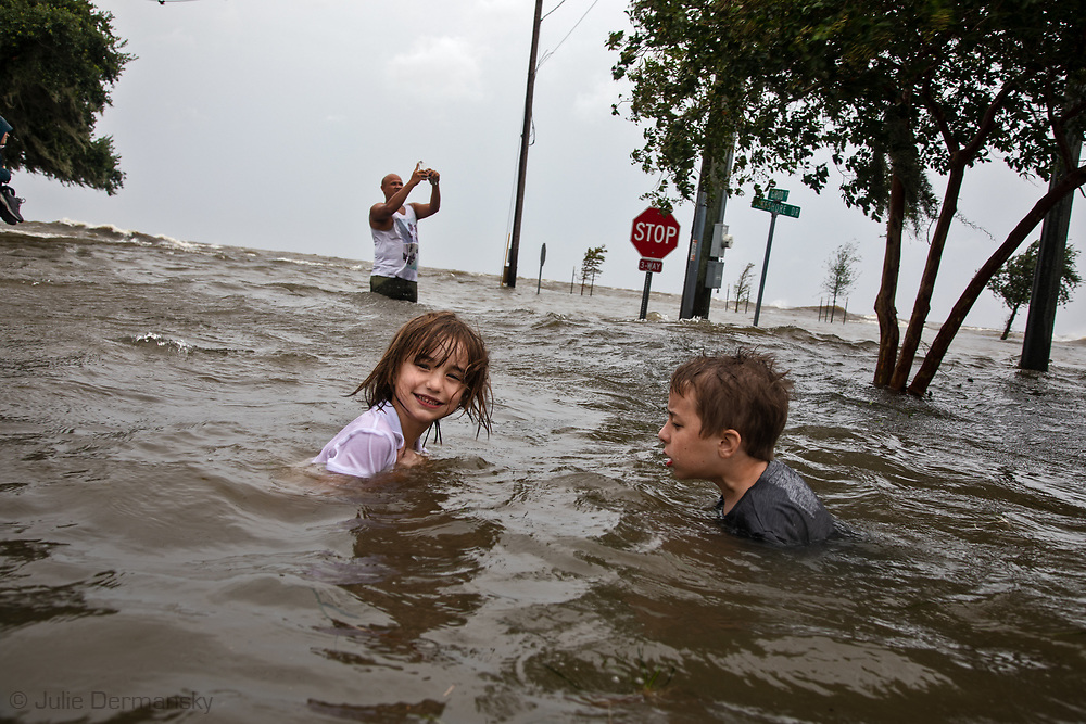 People flocked to see the floodwater at Mandeville's lakefront after Tropical storm Barry turned into Hurricane Barry and water pushed in from Lake Pontchartrain.
