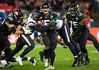American Football - 2019 NFL Season (NFL International Series, London Games) - Houston Texans vs. Jacksonville Jaguars<br /> <br /> Gardner Minshew, Quarterback, (Jacksonville Jaguars) sacked at Wembley Stadium.<br /> <br /> COLORSPORT/DANIEL BEARHAM