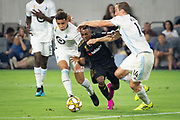LAFC forward Latif Blessing (7) tries to moves the ball past Minnesota United defenders Brent Kallman (14) and \m32\ during an MLS soccer match against the Minnesota United. Minnesota United defeated the LAFC 2-0 on Sunday Sept. 1 2019, in Los Angeles. (Ed Ruvalcaba/Image of Sport)
