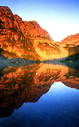 Upper Geiger Lake at sunrise in summer. Cabinet Mountains Wilderness Area, Montana