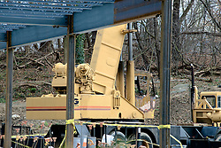Signs of vandalism are show at the construction site of the Quaker Meeting House in Chestnut Hill.  ..The operating cabin of a construction crane is rendered useless by fire. The crane is parked on the construction site of the future new Quakers Meeting House in Chestnut Hill. .
