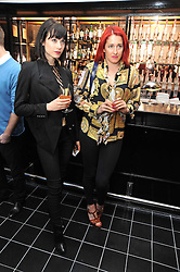 Left to right, ANNIE MUNROE and AMY MOLYNEAUX at a brunch hosted by Zac Posen to launch the Belvedere Bloody Mary Brunch held at Le Caprice, 25 Arlington Street, London on 7th April 2011.
