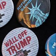 """Humorous political Anti Trump Buttons:  """"Wall off Trump"""" and """"Refugees Banned"""" for sale."""