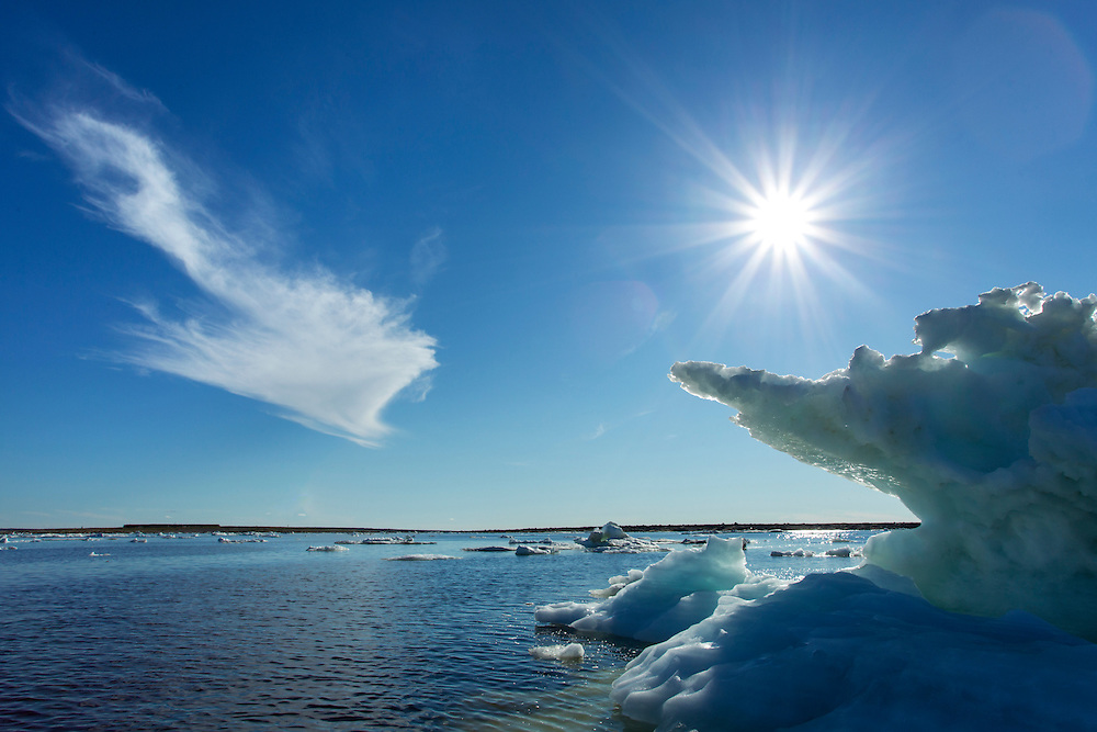Canada, Manitoba, Churchill, Melting sea ice and icebergs on Hudson Bay on summer evening